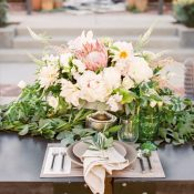 Stunning Summer Centerpiece with Peony and Protea Blossoms and a Greenery Runner