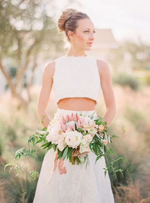 Crop Top Wedding Dress with a Blush Protea Bouquet