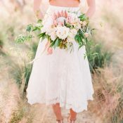Tea Length Two Piece Wedding Dress with a Blush Bouquet and Platform Heels