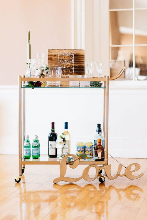 Modern indoor garden wedding in an elegant ballroom hey wedding lady modern bar cart with a gold love sign workwithnaturefo