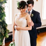 Romantic Classic Bride and Groom Under the Ceremony Arch