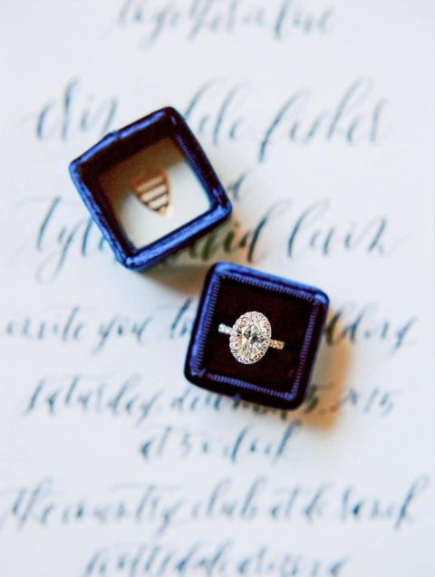 Oval Halo Engagement Ring in a Blue Velvet Box