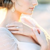 Bride with Romantic Vintage Earrings and an Oval Engagement Ring
