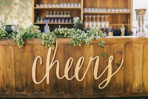 Natural Wood Bar With Gold Laser Cut Signage And A Hops Garland