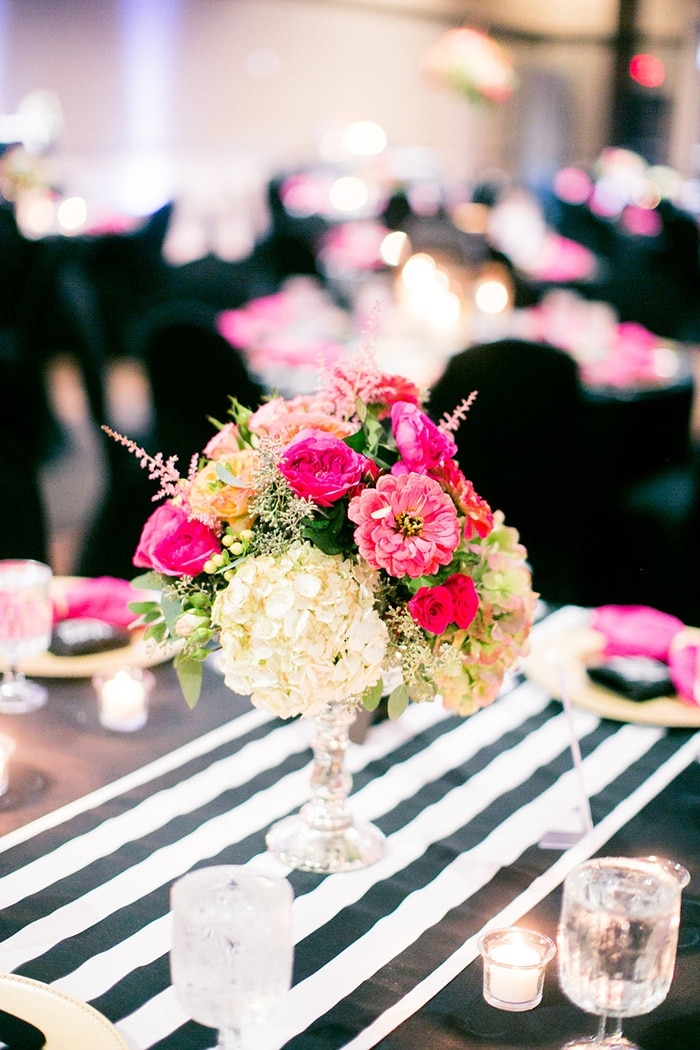 Black And White Striped Table Runners With A Bright Pink Centerpiece