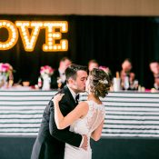 Romantic First Dance with a LOVE Marquee