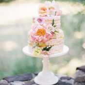 Naked Wedding Cake with Strawberry Frosting and Pastel Flowers