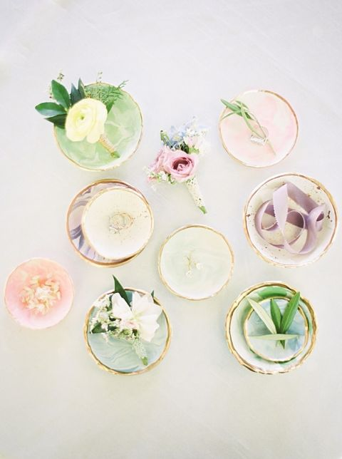 Marble and Gold Ring Dishes Filled with Jewelry and Flowers