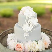 Gray Floral Wedding Cake in a Wine Barrel