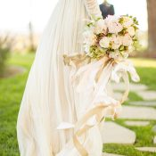 Champagne Chiffon Wedding Dress with a Blush Bouquet