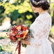 Dreamy Vintage Bride in a Long Sleeve Lace Wedding Dress with Jewel Toned Flowers
