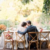 Bride and Groom at an Elegant Farm Table in Fall Colors