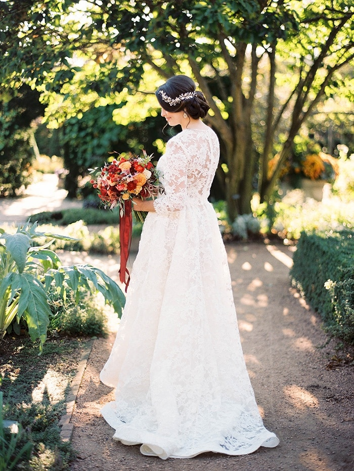 Graceful Lace Wedding Dress for a Vintage Bride in an Autumn Garden