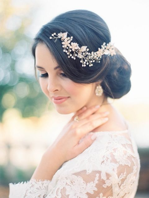 Elegant Bridal Updo with a Gold and Pearl Headpiece