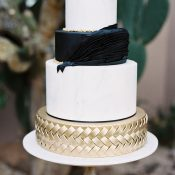 Modern Chic Black and Gold Wedding Cake with Braided Accents