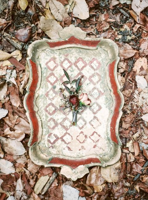 Red and Gold Vintage Tray with a Boutonniere for the Groom