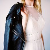 Studs and Lace Wedding Dress with a Leather Jacket