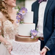 Wedding Cake with Purple Flowers and Metallic Geometric Details