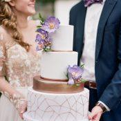 Wedding Cake with Purple Flowers and Metallic Geometric Details