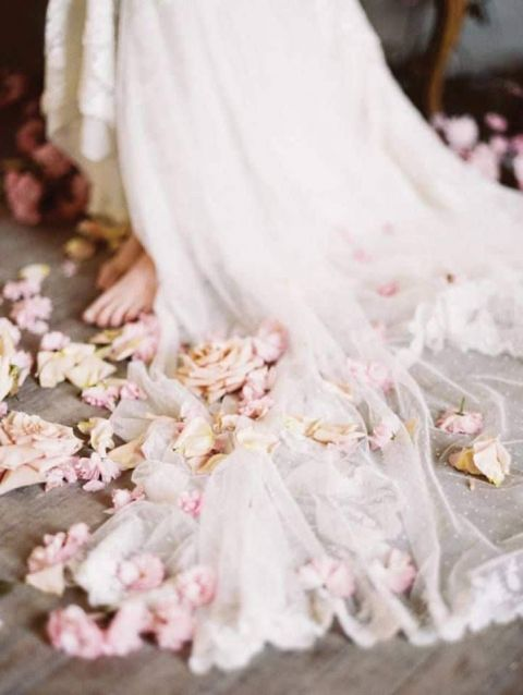 Barefoot Bride in an Ethereal Lace Wedding Dress with Scattered Flowers