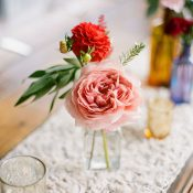 Table Runner with Flowers in Bud Vases and Mercury Glass Votives