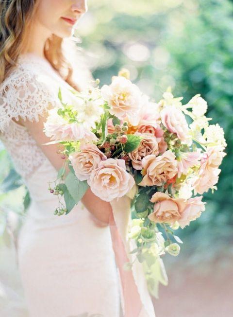 Romantic Peach Bouquet with a Lace Wedding Dress