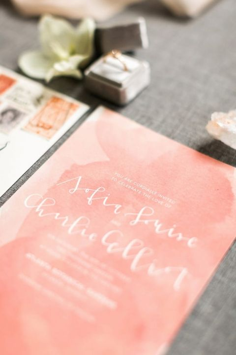White Calligraphy Invitations over Peach Watercolors