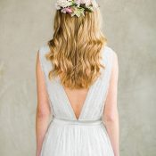 Open Back Wedding Dress with a Floral Hair Adornment