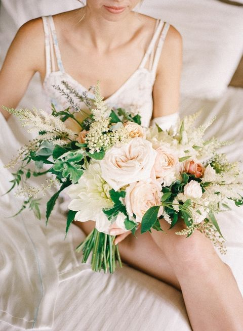 Bride Getting Ready for her Wedding Day with her Bouquet