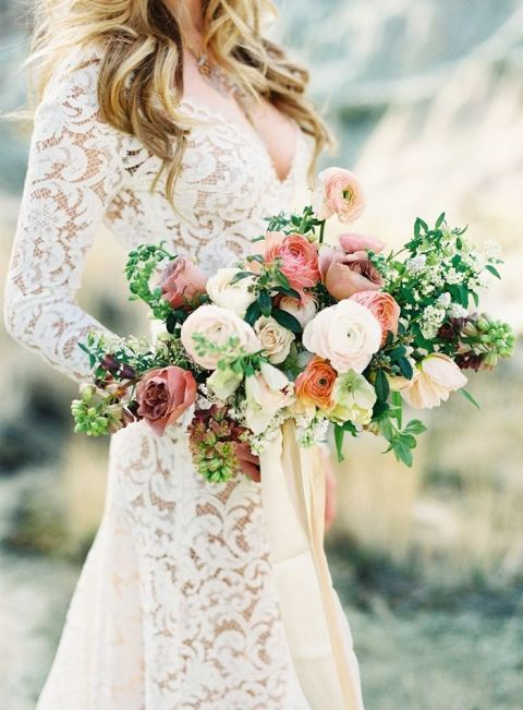 Lace Wedding Dress With Long Sleeves And A Coral Bouquet