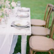 Farm Table with Flowing Linen Table Runner and Spring Flowers
