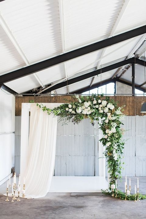 Industrial Ceremony with Greenery Garlands and Ethereal Drapery