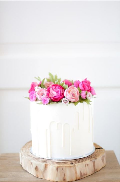 White Chocolate Drip Cake with Pink Wax Flowers