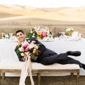 Groom Relaxing with the Bouquet