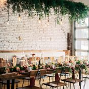 Rustic Industrial Reception with a Candle Runner and Greenery Chandelier