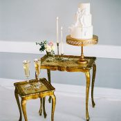 Vintage Gold Wedding Cake Table with a Bow Cake
