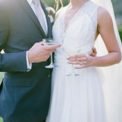 Bride and Groom Share a Toast with Vintage Coupes