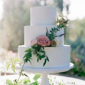 White Wedding Cake with Purple Garden Flowers