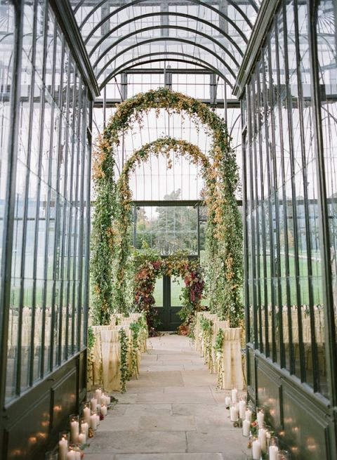 Conservatory Wedding Ceremony with Greenery Garlands