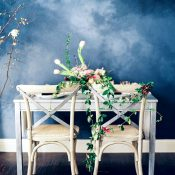 Vintage Sweetheart Table with a Painted Blue Backdrop