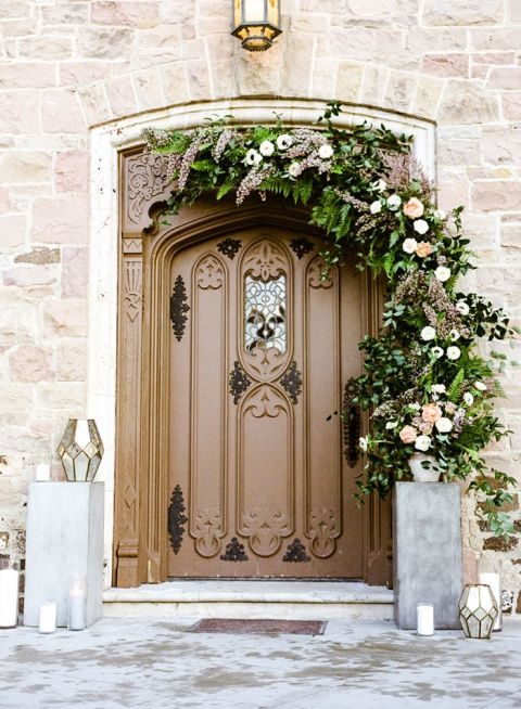 Antique Door with Floral Garlands and Lanterns