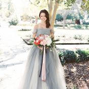 Gray Tulle Wedding Dress with a Coral Bouquet