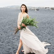 Flowing Champagne Wedding Dress with a Greenery Bouquet