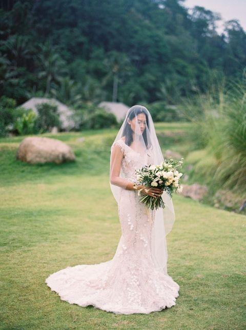 Romantic Lace Wedding Dress with a Drop Veil