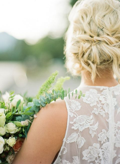 Romantic Bridal Updo with a Lace Back Wedding Dress