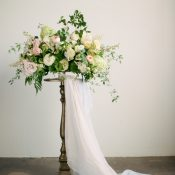 Blush and Greenery Centerpiece on a Vintage Pedestal Table