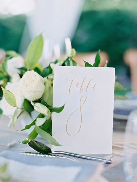 Gold Calligraphy Table Number with Green and White Flowers
