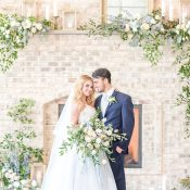 Lush Greenery and Spring Flowers with Metallic Candles and Decor