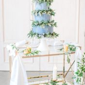 Blue Marbled Wedding Cake with Greenery Wreaths