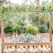 Farm Table with a Rustic Arbor and Crystal Chandelier